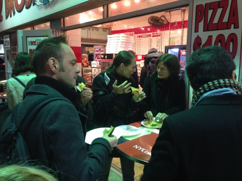 International participants eating New York pizza for the first time in between rehearsal visits and an evening performance.